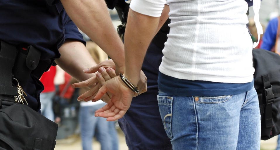 stock image of a woman being arrested