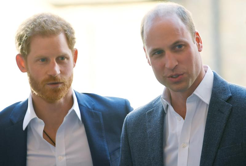 Prince William and Prince Harry probably staring at light switches they'd like to turn off. (Getty)