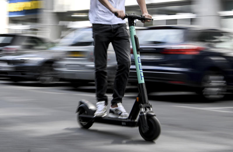 A man drives an electric pedal scooter from Tier in Berlin, Germany. | Britta Pedersen—picture-alliance/dpa/AP