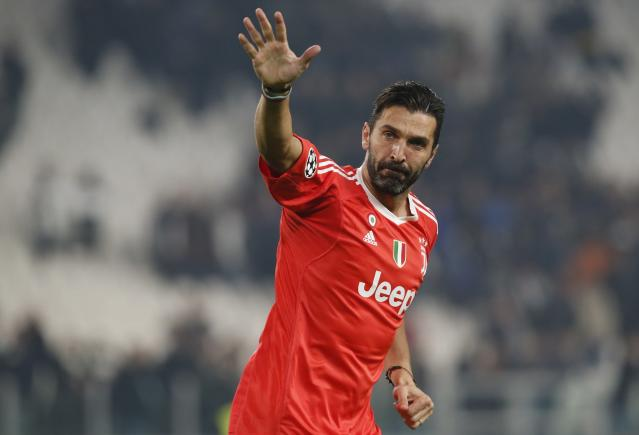 FILE - In this Nov. 22, 2017 file photo Juventus goalkeeper Gianluigi Buffon waves to fans at the end of the Champions League group D soccer match between Juventus and Barcelona, at the Allianz Stadium in Turin, Italy. Buffon on Friday, July 6, 2018 signed for Paris Saint-Germain as a free agent, penning a one-year deal with the option for an additional season. (AP Photo/Antonio Calanni, file)
