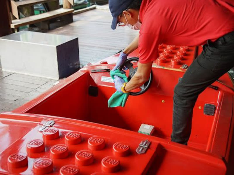 A worker at Legoland Malaysia gets ready for the theme park's reopening.