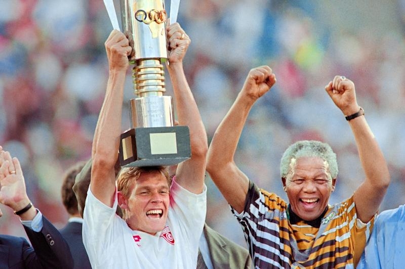 Neil Tovey celebrates with Nelson Mandela in 1996 after South Africa won the Africa Nations Cup