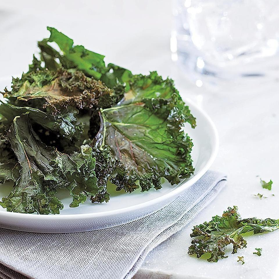 <p>Not a fan of kale? These crispy baked kale chips will convert you! For the best result, don't overcrowd the pans.</p>