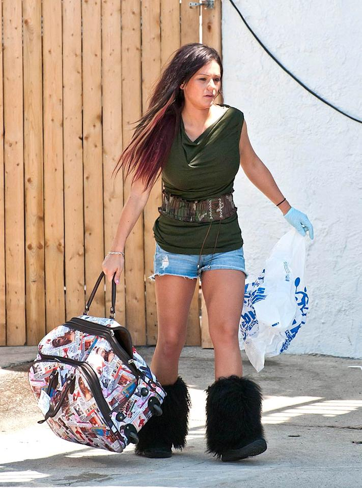 "Judging from her frazzled appearance, Jenni ""JWoww"" Farley must have packed her bag at the very last minute! <a href=""http://www.infdaily.com"" target=""new"">INFDaily.com</a> - July 27, 2011"