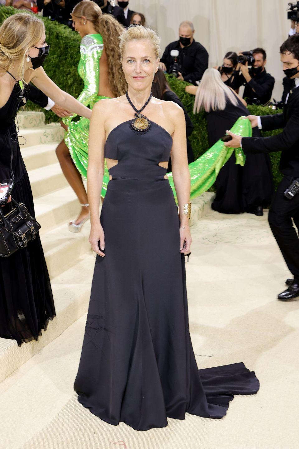 <p>Gillian Anderson wore a halter neck black Gabriela Hearst gown to the Met Gala.</p>