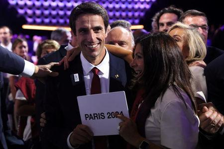 International Olympic Committee (IOC) member and Co-Chairman of Paris 2024 Tony Estanguet and Mayor of Paris Anne Hidalgo react after the ratification of Paris 2024 and Los Angeles 2028 host cities for Olympic games during the 131st IOC session in Lima, Peru, September 13, 2017. REUTERS/Guadalupe Pardo