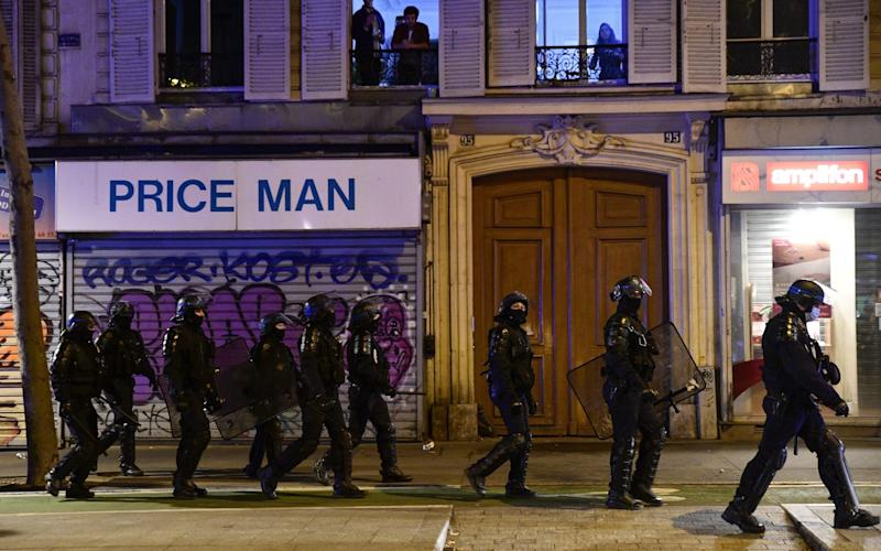 Riot police were called out to tackle an anti-curfew protest - Julien Mattia/Anadolu Agency via Getty Images