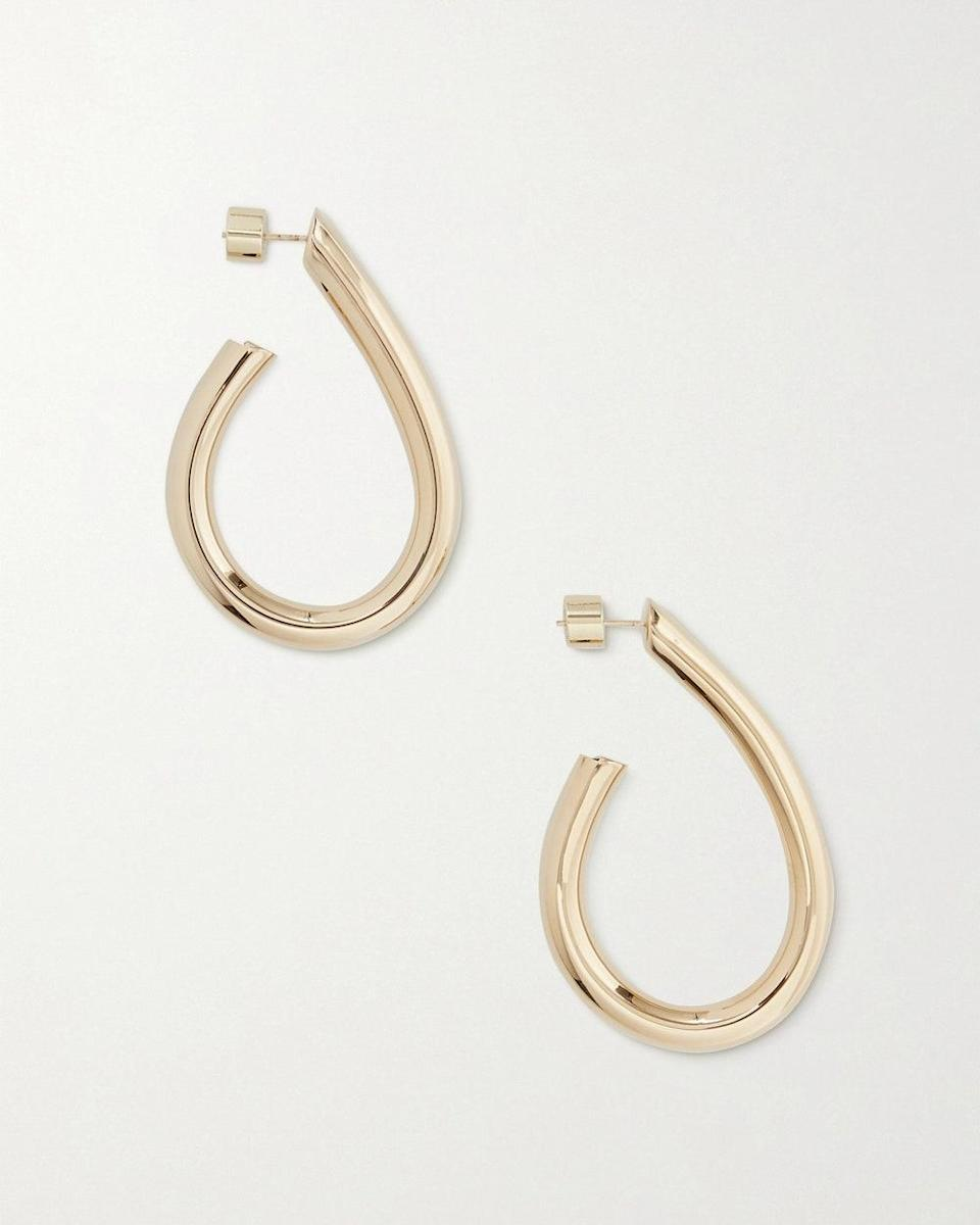 """""""Every outfit needs a Jennifer Fisher hoop. I love the unique, teardrop shape of these hoops, so once I saw them go on sale, it was an immediate add-to-cart."""" - <em>Jessica Neises, Assistant Fashion Editor</em> $325, Net-a-Porter. <a href=""""https://www.net-a-porter.com/en-us/shop/product/jennifer-fisher/jewelry-and-watches/earrings/teardrop-samira-mini-gold-plated-hoop-earrings/4394988608983614"""" rel=""""nofollow noopener"""" target=""""_blank"""" data-ylk=""""slk:Get it now!"""" class=""""link rapid-noclick-resp"""">Get it now!</a>"""