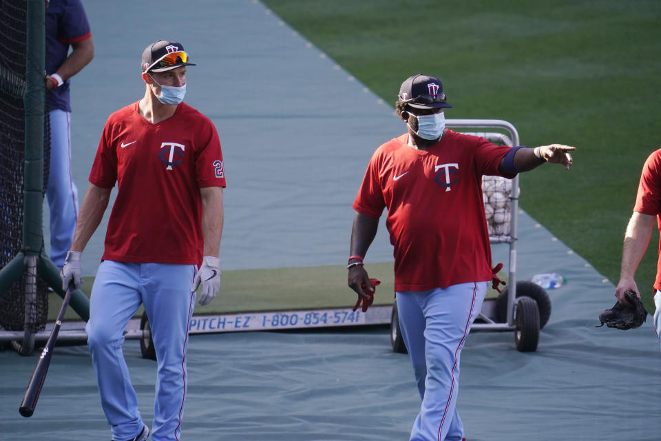 Minnesota Twins players wear masks during batting practice amid the COVID-19 pandemic, before a baseball game against the Los Angeles Angels on Friday, April 16, 2021, in Anaheim, Calif. (AP Photo/Marcio Jose Sanchez)