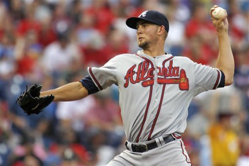 Atlanta Braves starting pitcher Mike Minor throws against the Philadelphia Phillies in the first inning of a baseball game, Tuesday, Aug. 7, 2012, in Philadelphia. (AP Photo/H. Rumph Jr)