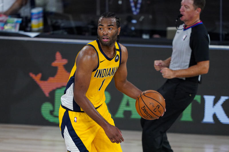 Indiana Pacers forward T.J. Warren (1) plays against the Orlando Magic during the second half of an NBA basketball game Tuesday, Aug. 4, 2020 in Lake Buena Vista, Fla. (AP Photo/Ashley Landis)