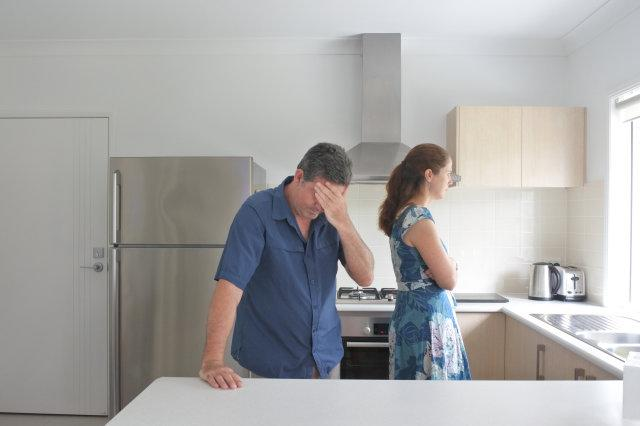 Upset Couple in Home Kitchen