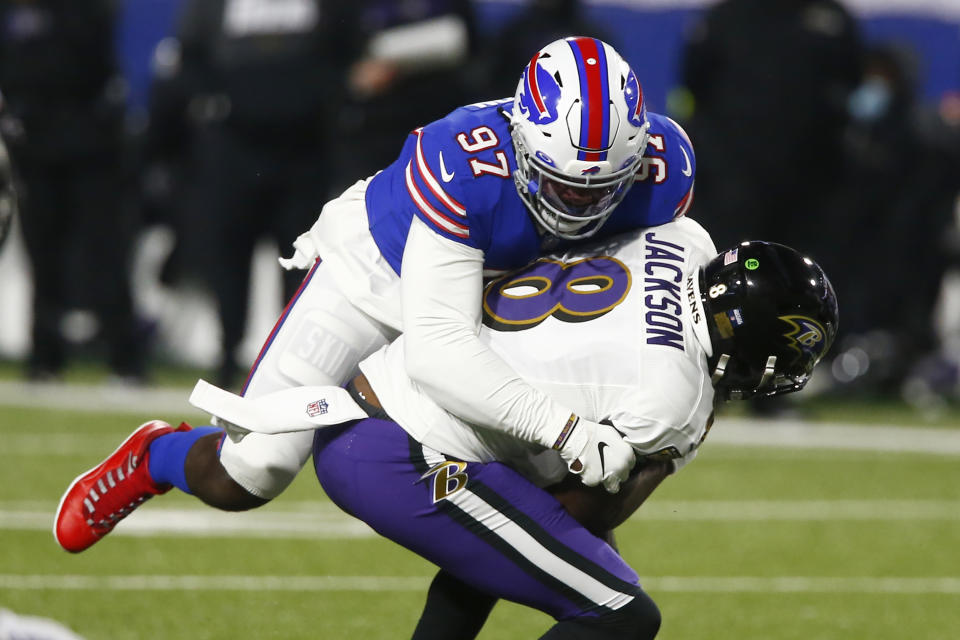 Buffalo Bills defensive end Mario Addison (97) sacks Baltimore Ravens' Lamar Jackson (8). (AP Photo/John Munson)