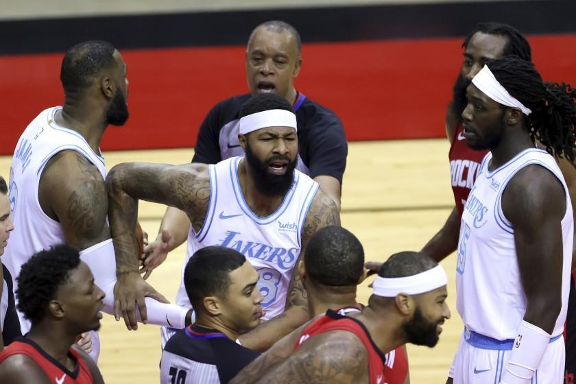 Lakers forward Markieff Morris chases after Rockets center DeMarcus Cousins after the two traded shoves on Jan. 10, 2020.