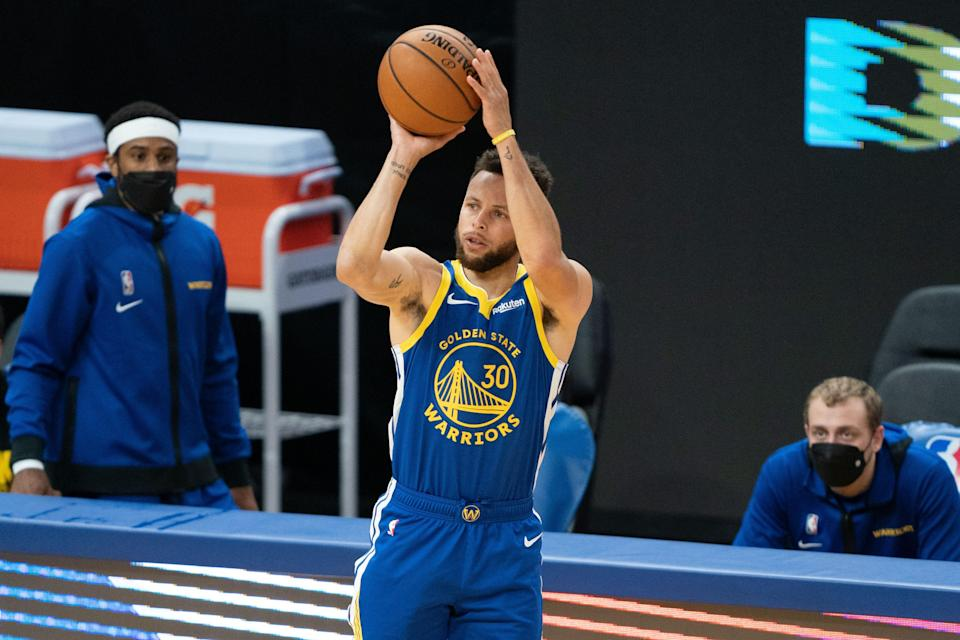 Golden State Warriors guard Stephen Curry (30) shoots the basketball during the first quarter against the Denver Nuggets at Chase Center.