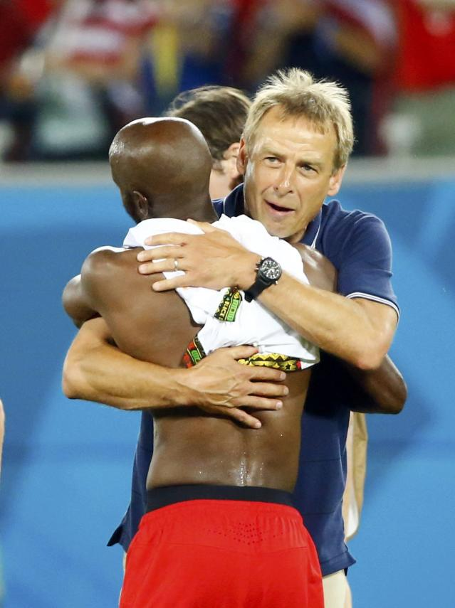 U.S. coach Juergen Klinsmann hugs DaMarcus Beasley after they won Ghana in their 2014 World Cup Group G soccer match at the Dunas arena in Natal June 16, 2014. REUTERS/Stefano Rellandini (BRAZIL - Tags: SOCCER SPORT WORLD CUP)