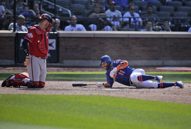 New York Mets' Jose Bautista, right, gets up after almost being hit by a pitch while Washington Nationals catcher Jamie Burke looks on during the ninth inning of the baseball game at Citi Field, Sunday, July 15, 2018, in New York. (AP Photo/Seth Wenig)