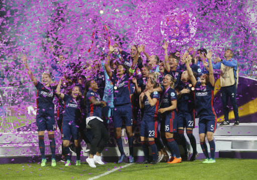 Lyon players jubilate under confetti after winning their UEFA Women's Champions League Final soccer match against Wolfsburg at the Valeriy Lobanovskiy stadium in Kiev, Ukraine, Thursday, May 24, 2018. (AP Photo/Efrem Lukatsky)