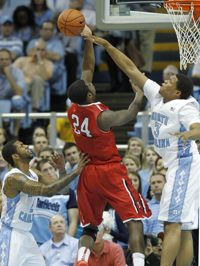 North Carolina's Kennedy Meeks (3) blocks a shot by Davidson's De'Mon Brooks (24) as North Carolina's Leslie McDonald, left, looks on during the first half of an NCAA college basketball game in Chapel Hill, N.C., Saturday, Dec. 21, 2013. (AP Photo/Ellen Ozier)