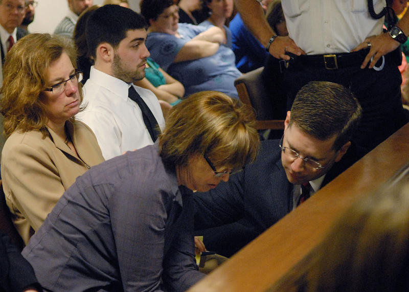 Anne O'Brien, mother of Phoebe Prince, talks with First Assistant District Attorney Steven Gagne during Kayla Narey's hearing where she admitted to sufficient facts of criminal harassment in Franklin - Hampshire Juvenile Court in Northampton, Mass., Wednesday, May 4, 2011. Narey was accused of bullying Prince so relentlessly that the 15-year-old hanged herself. (AP Photo/Gordon Daniels, Pool)