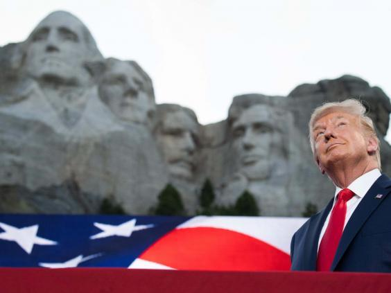 Donald Trump stands in front of Mount Rushmore (AFP via Getty Images)