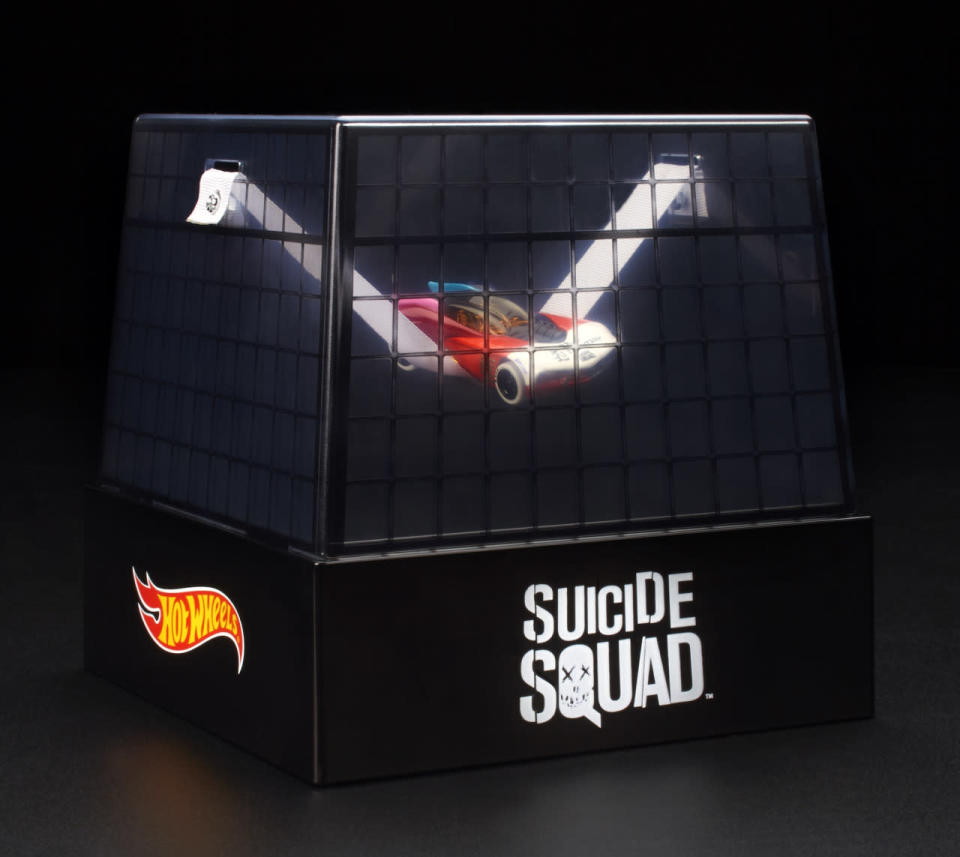 """<p>This Hot Wheels vehicle riffs on Margot Robbie's <i>Suicide Squad</i> psychopath, featuring tattoos that read """"Daddy's Lil Monster"""" and """"Property of Joker,"""" this die-cast car is suspended in packaging modeled after Harley's Arkham Asylum cell in the movie ($25)</p>"""