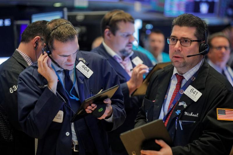 Wall Street slips from records after jobs data, but posts weekly gains