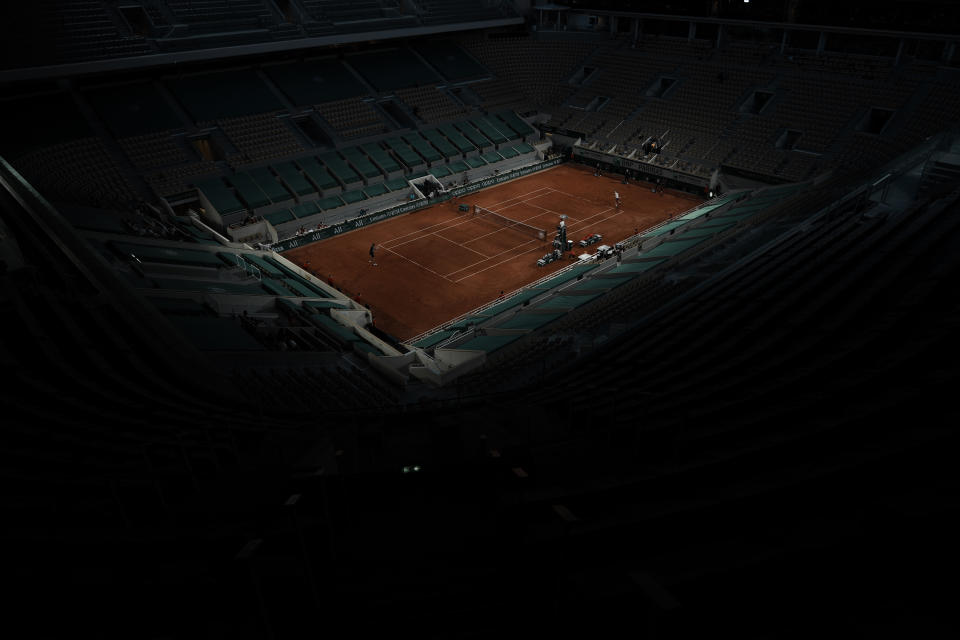 Stefanos Tsitsipas of Greece, right, plays Russia's Daniil Medvedev on the Philippe Chatrier court during their quarterfinal match of the French Open tennis tournament at the Roland Garros stadium Tuesday, June 8, 2021 in Paris. (AP Photo/Thibault Camus)