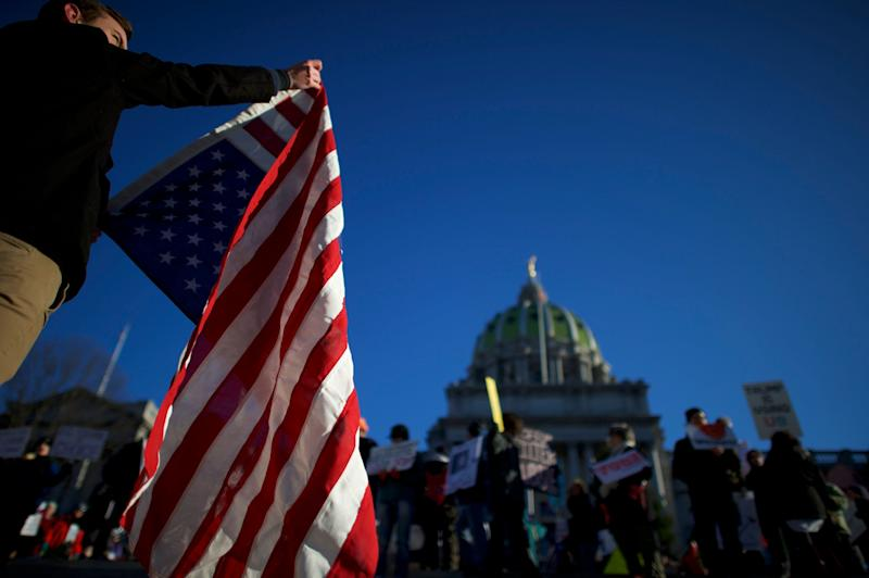 Protesters demonstrate outside the Pennsylvania Capitol in Harrisburg in December 2016.