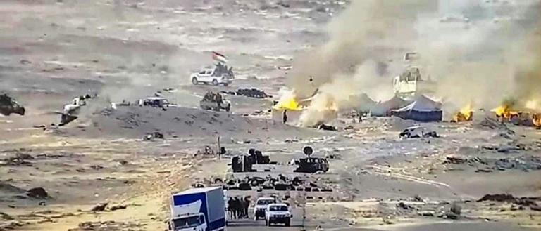 Tents used by the Polisario Front ablaze near the Mauritanian border in Guerguerat in the Western Sahara, along the road leading to Mauritania, after the intervention of Moroccan armed forces, in picture supplied by the army