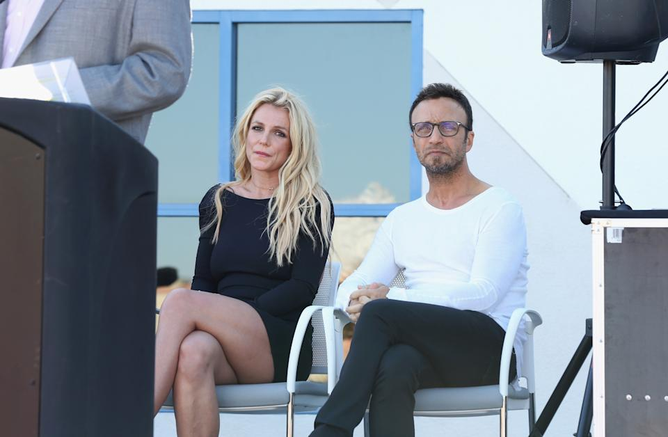 LAS VEGAS, NV - NOVEMBER 04:  Singer Britney Spears (L) and talent manager Larry Rudolph listen to Clark County Commissioner Steve Sisolak's speech during the grand opening of the Nevada Childhood Cancer Foundation Britney Spears Campus on November 4, 2017 in Las Vegas, Nevada.  (Photo by Gabe Ginsberg/Getty Images)