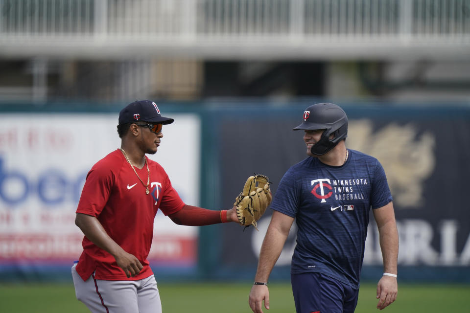 Minnesota Twins shortstop Jorge Polanco, left, tags out another player during spring training baseball practice on Wednesday, Feb. 24, 2021, in Fort Myers, Fla. (AP Photo/Brynn Anderson)