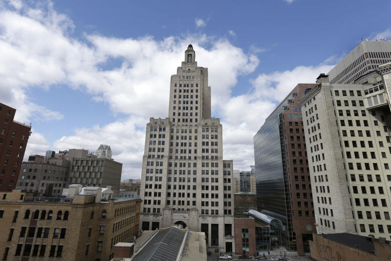 "In this Wednesday, March 27, 2013 photo, the Bank of America Building, center, stands near other buildings in downtown Providence, R.I.  The Art Deco-style skyscraper, tallest in the state, is losing its last tenant when the bank's lease expires in April. The building is known to some as the ""Superman building,"" for its similarity to the Daily Planet headquarters in the old Superman TV show.  (AP Photo/Steven Senne)"