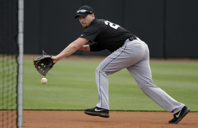Major League Baseball free agent third baseman Chris Johnson fields a ground ball during infield drills before a scrimmage, Tuesday, Feb. 27, 2018, in Bradenton, Fla. (AP Photo/Chris O'Meara)