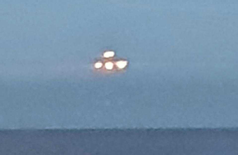 Matthew Evans, 36, spotted the bright unidentified object while looking out of his top-floor flat window last week.(SNWS)