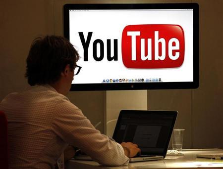 The YouTube logo is seen on a screen in a file photo.