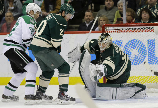 Dallas Stars right wing Erik Cole, left, and Minnesota Wild defenseman Ryan Suter watch as a shot by Stars left wing Ryan Garbutt gets past Wild goalie Darcy Kuemper, right, for a goal during the second period of an NHL hockey game in St. Paul, Minn., Saturday, Jan. 18, 2014. (AP Photo/Ann Heisenfelt)