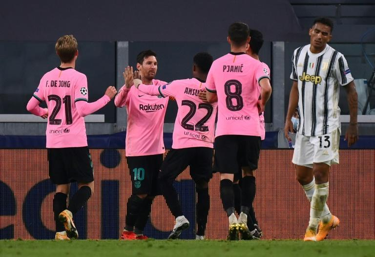 Barcelona forward Lionel Messi celebrates after scoring his 117th Champions League goal