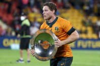Australia's Michael Hooper holds the Nelson Mandela Plate after defeating South Africa in the Rugby Championship test match between the Springboks and the Wallabies in Brisbane, Australia, Saturday, Sept. 18, 2021. (AP Photo/Tertius Pickard)