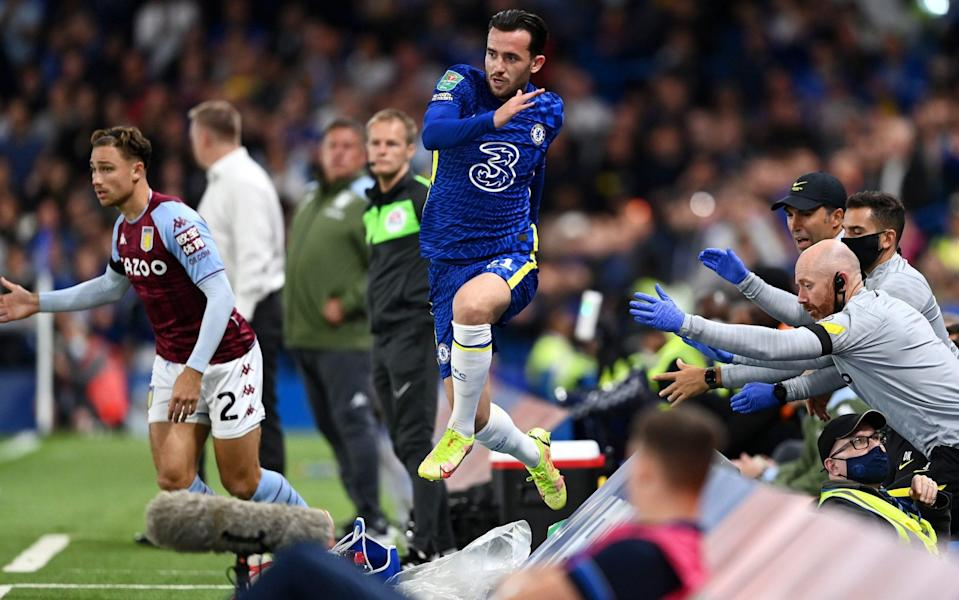 Ben Chilwell of Chelsea falls into the backroom staff during the Carabao Cup Third Round match between Chelsea and Aston Villa at Stamford Bridge - Darren Walsh/Chelsea FC via Getty Images
