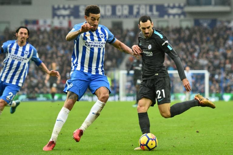 Brighton's defender Connor Goldson (left) vies with Chelsea's Davide Zappacosta during their English Premier League match in Brighton on January 20, 2018