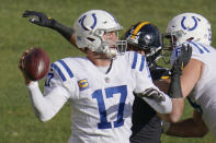 Indianapolis Colts quarterback Philip Rivers (17) gets off a pass as Pittsburgh Steelers linebacker Alex Highsmith (56) pressures him during the first half of an NFL football game, Sunday, Dec. 27, 2020, in Pittsburgh. (AP Photo/Gene J. Puskar)