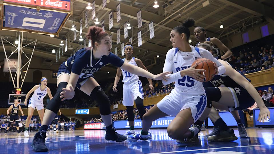 DURHAM, NC - JANUARY 26: Jade Williams #25 of Duke University beats Lorela Cubaj #13 of Georgia Tech to a loose ball during a game between Georgia Tech and Duke at Cameron Indoor Stadium on January 26, 2020 in Durham, North Carolina. (Photo by Andy Mead/ISI Photos/Getty Images)