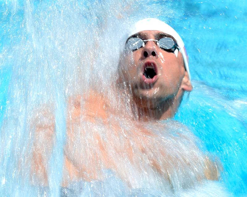 Michael Phelps swims in the 100m backstroke prelims during the US Championships in Irvine, California on August 9, 2014