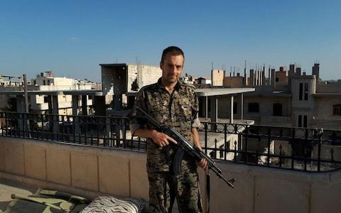 Jamie Janson fighting in northern Syrian with the YPG - Credit: The Telegraph