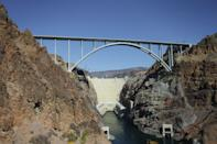 A survey image of the Hoover Dam and Mike O'Callaghan-Pat Tillman Memorial Bridge from the heliport in Boulder City, Nev. The structure is dedicated to the memories of former Arizona Cardinal Pat Tillman and former Nevada Governer Mike O'Callaghan (AP Photo/Pablo Martinez Monsivais)