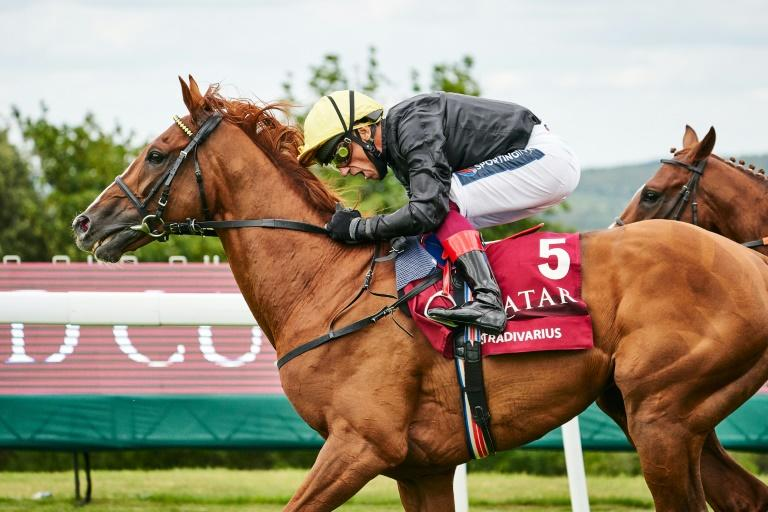 Stradivarius, ridden by Frankie Dettori, beat Nayef Road by a length to win the Goodwood Cup for a record fourth time