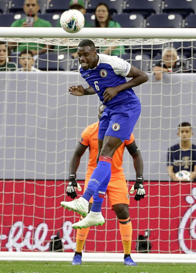 Haiti defender Jems Geffrard (6) heads the ball away from the goal on a shot attempt by Canada during the first half of a CONCACAF Gold Cup soccer quarterfinal Saturday, June 29, 2019, in Houston. (AP Photo/Michael Wyke)