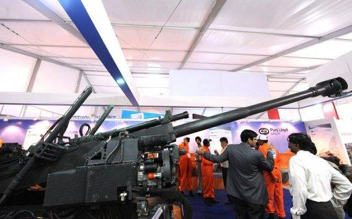 Singapore Technologies Kinetics, pictured exhibiting a Howitzer at a 2010 industry event, is among six blacklisted firms