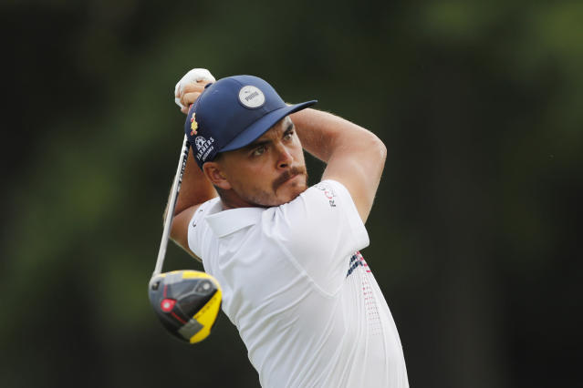 Rickie Fowler drives off the 17th tee during the second round of the Rocket Mortgage Classic golf tournament, Friday, July 3, 2020, at the Detroit Golf Club in Detroit. (AP Photo/Carlos Osorio)